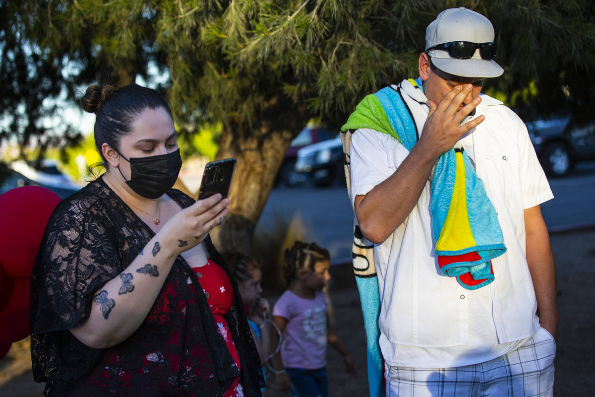 Vanessa Browning, left, reads a statement alongside Nicholas Husted, of San Jose, California, w ...