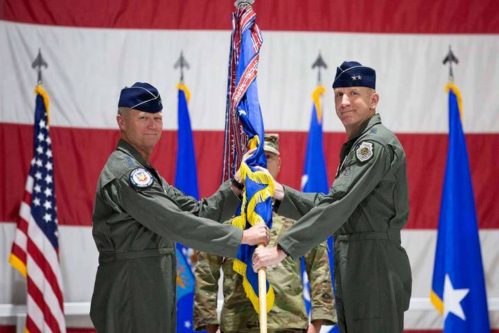 Gen. Mark Kelly, left, hands over command of the U.S. Air Force Warfare Center to Maj. Gen. Cas ...