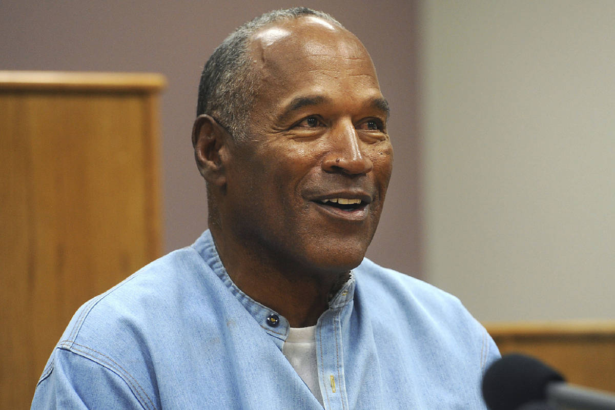 In this July 20, 2017 file photo, former NFL football star O.J. Simpson appears via video for h ...