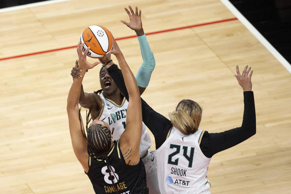 Las Vegas Aces center Liz Cambage (8) is blocked by New York Liberty guard Jazmine Jones (4) an ...