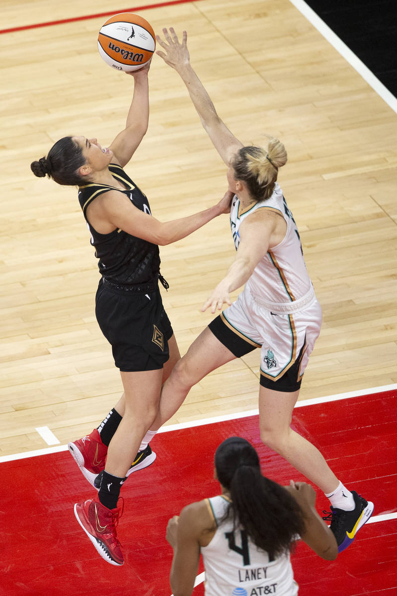 Las Vegas Aces guard Kelsey Plum (10) shoots a point while New York Liberty guard Sami Whitcomb ...