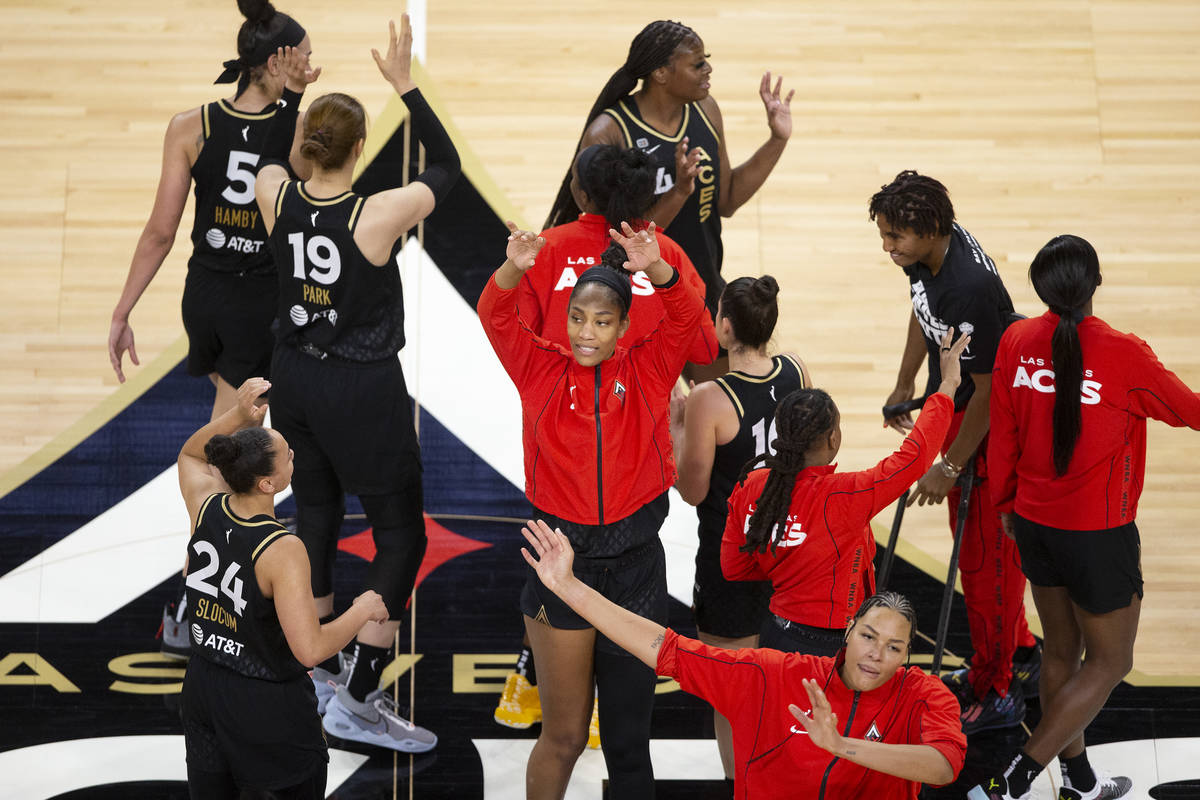 The Las Vegas Aces, including forward A'ja Wilson (22), center, and center Liz Cambage (8), bot ...