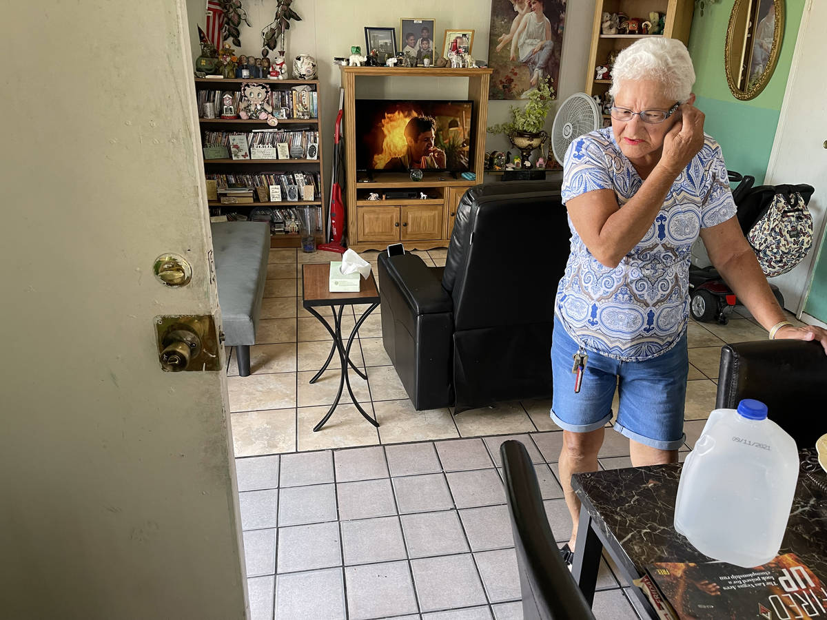 Carmen Millan, 82, uses a fan with open windows and door to keep cool at her apartment on East ...
