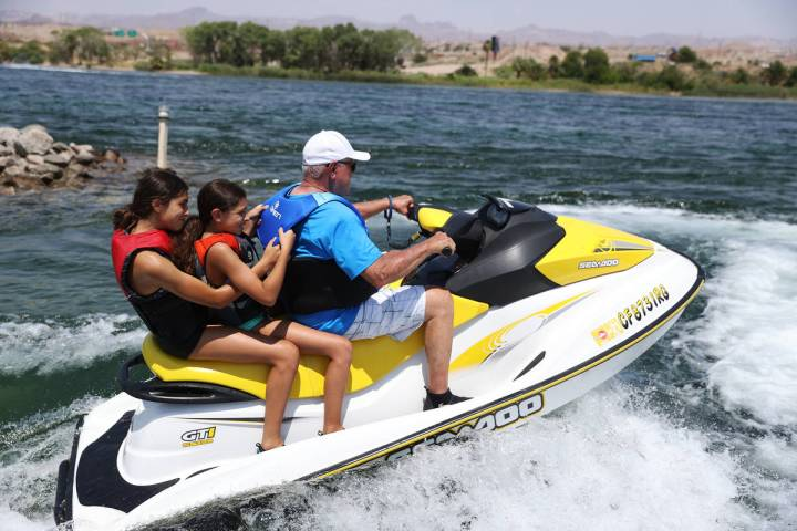 Tara Terrones, 13, from left, with her sister Tessa, 10, and grandfather Rick Fringer, take off ...