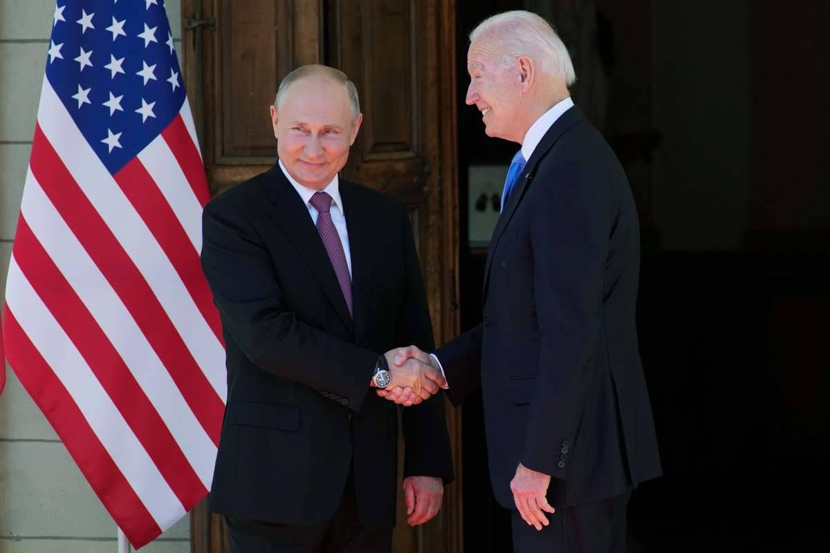 Russian President Vladimir Putin, left, and U.S President Joe Biden shake hands during their me ...