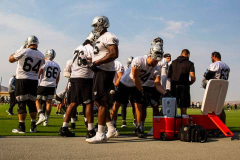 Raiders players hydrate during an NFL football minicamp at Raiders headquarters in Henderson on ...