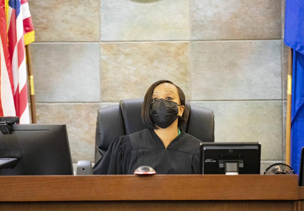 District Judge Tierra Jones presides over a court hearing for a trio of men with gang ties who ...