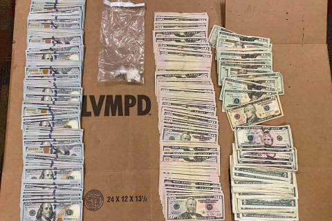 Las Vegas police seized more than $18,000 in cash and crack cocaine during an early-morning arr ...