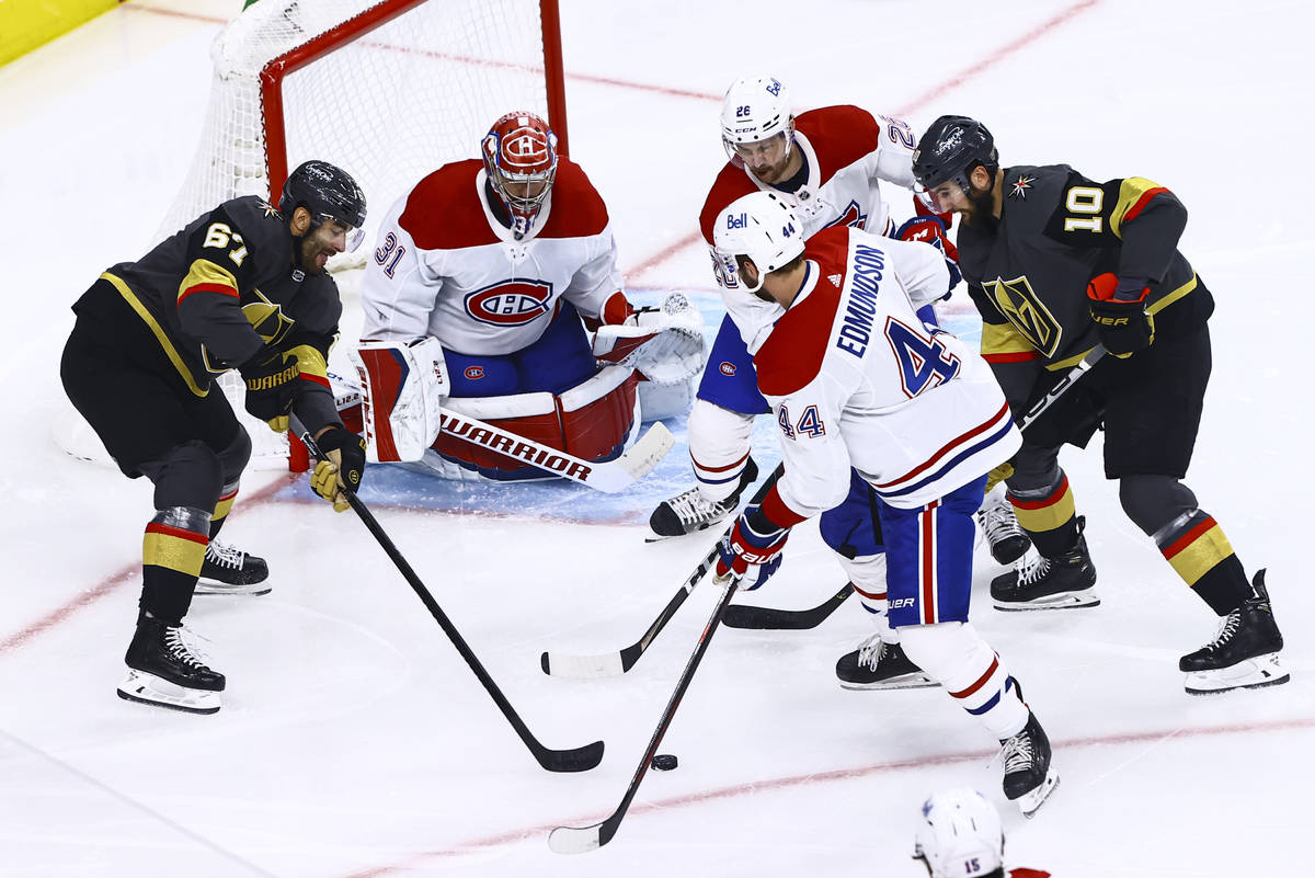 Golden Knights' Max Pacioretty (67) and Nicolas Roy (10) vie for the puck against Montreal Cana ...