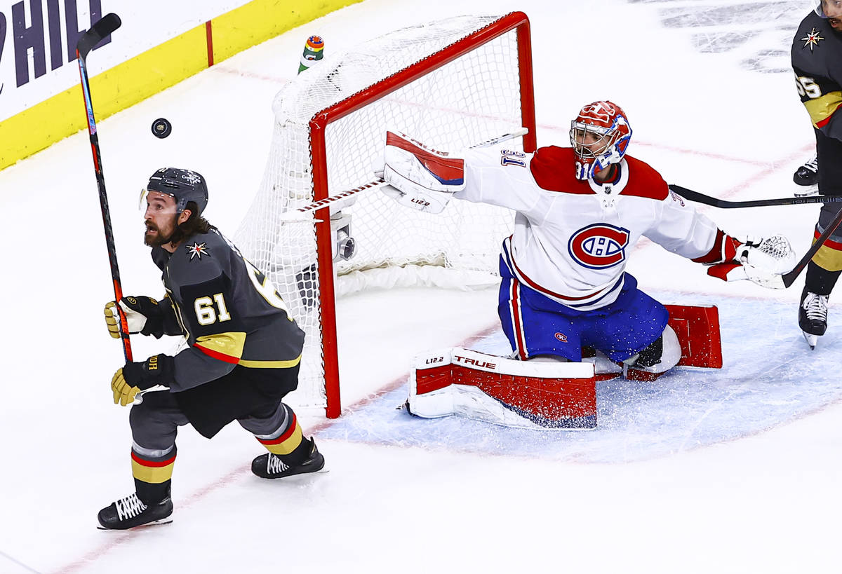 The puck flies over Golden Knights' Mark Stone (61) as Montreal Canadiens goaltender Carey Pric ...