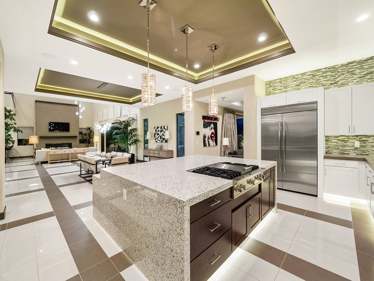 The kitchen features Viking appliances, a center island, separate bar seating and a wine room. ...