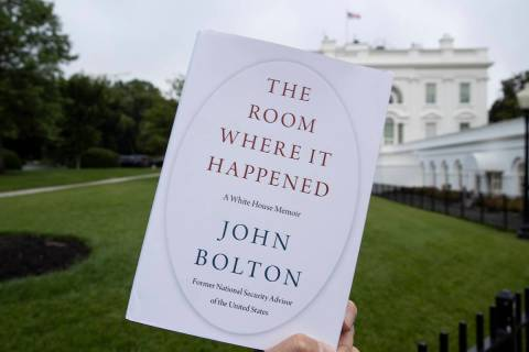 """FILE - In this June 18, 2020, file photo a copy of """"The Room Where It Happened,"""" by f ..."""
