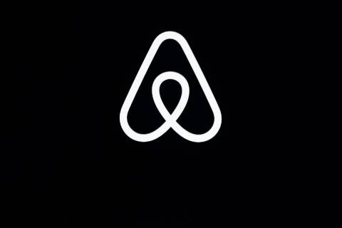 FILE - This Feb. 22, 2018, file photo shows an Airbnb logo during an event in San Francisco. Ai ...