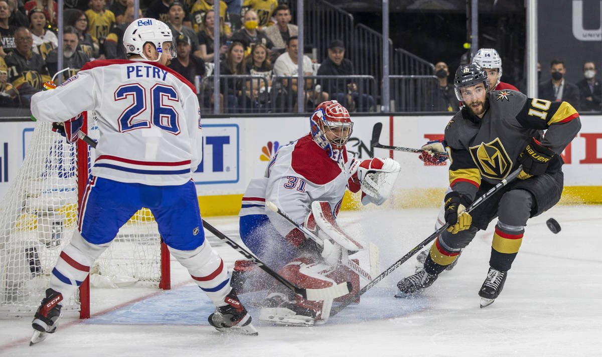 Golden Knights center Nicolas Roy (10) looks in the puck while closing in on Montreal Canadiens ...