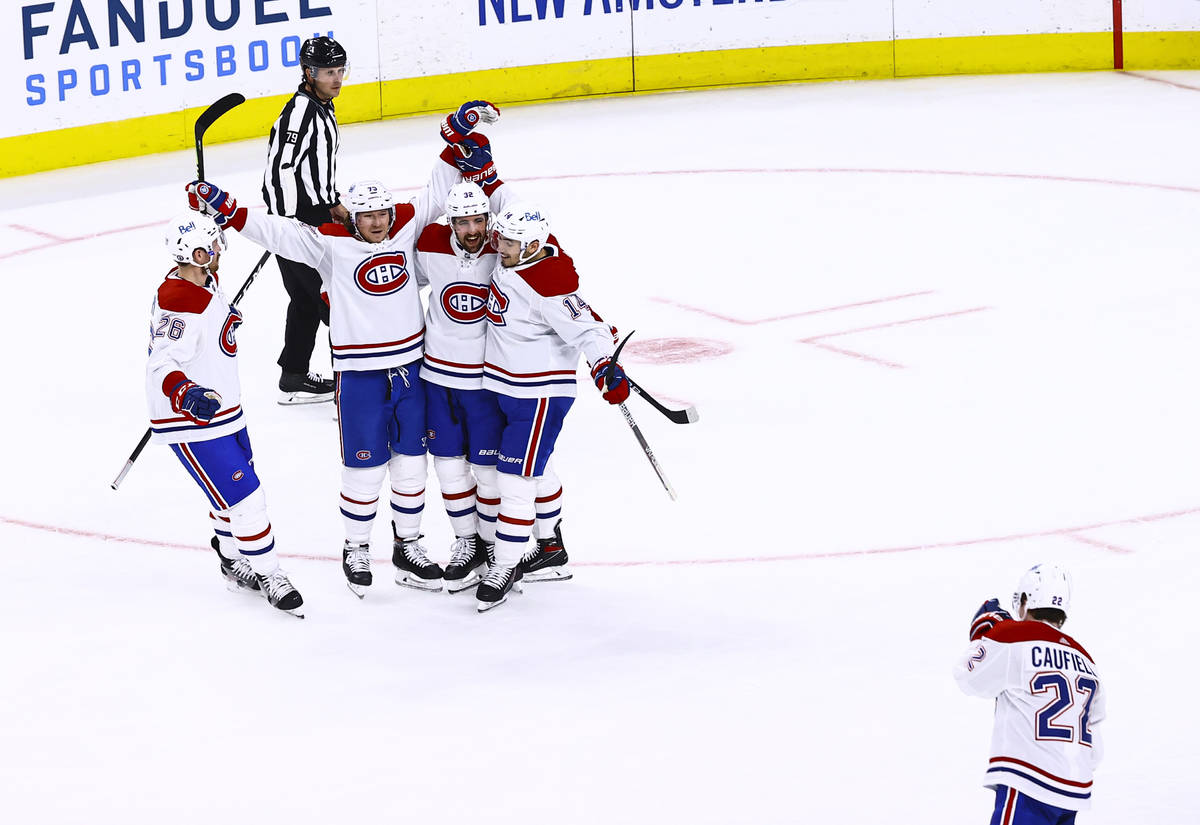 The Montreal Canadiens celebrate after scoring the second of two goals against the Golden Knigh ...