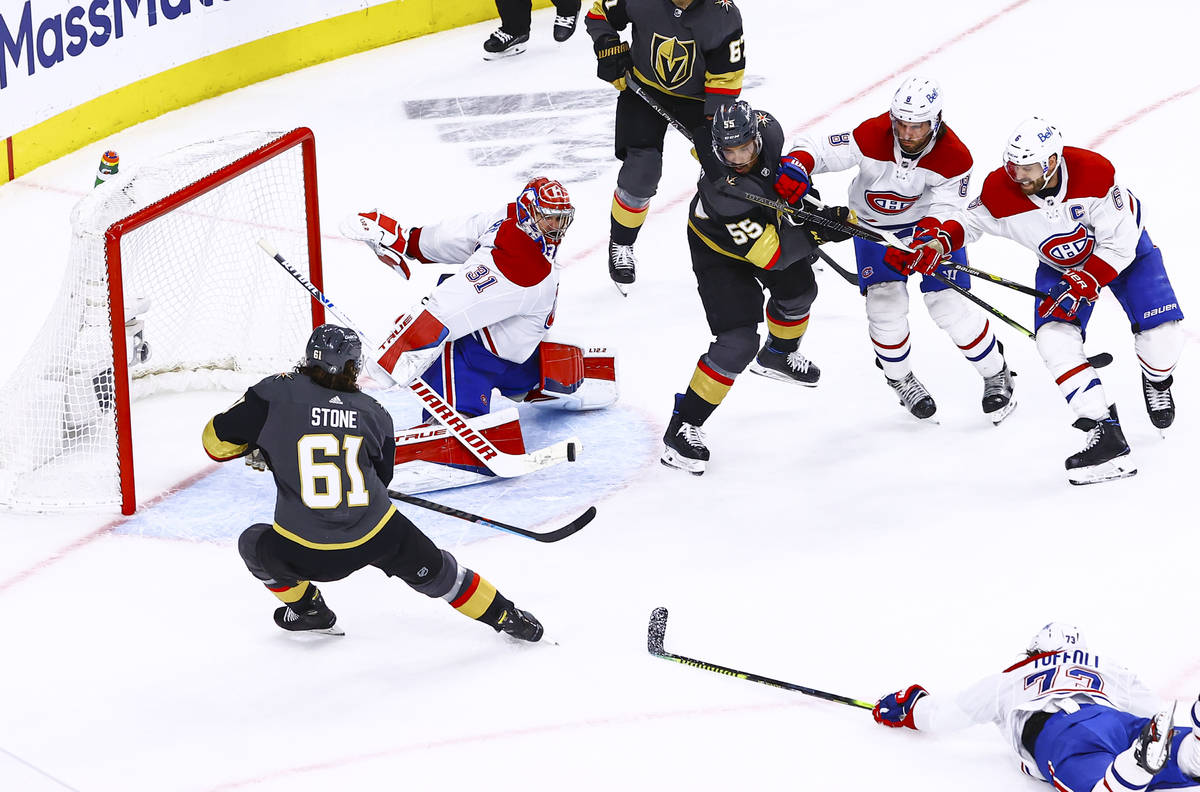 Montreal Canadiens goaltender Carey Price (31) blocks the puck in front of Golden Knights' Mark ...