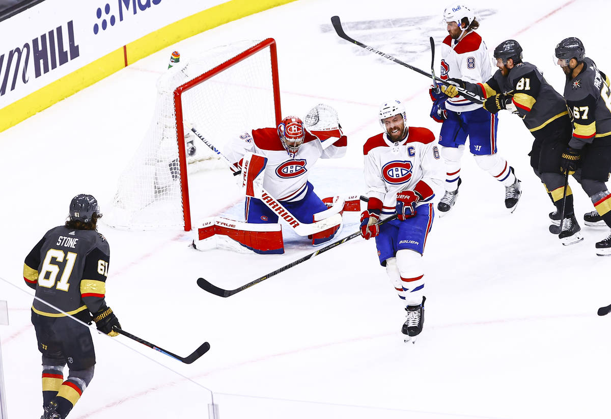 Montreal Canadiens' Shea Weber (6) blocks the puck in front of goaltender Carey Price (31) duri ...