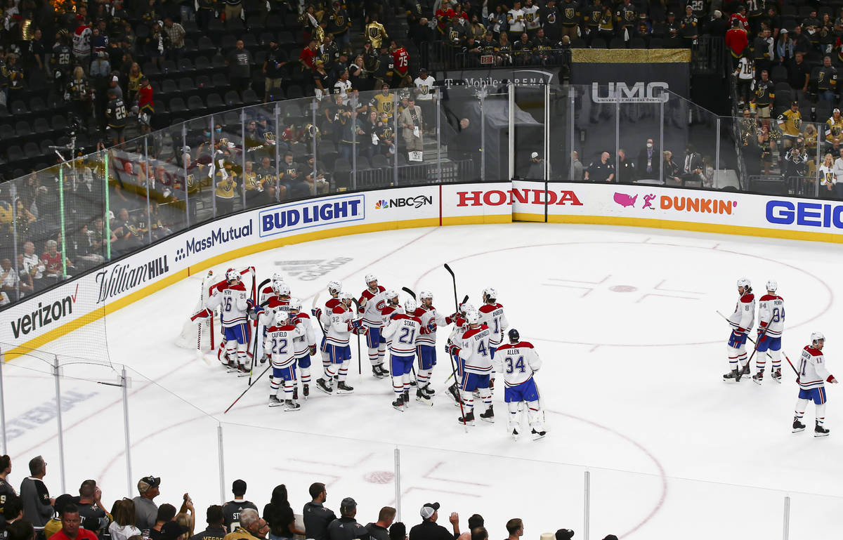 The Montreal Canadiens celebrate their 3-2 victory over the Golden Knights in Game 2 in an NHL ...