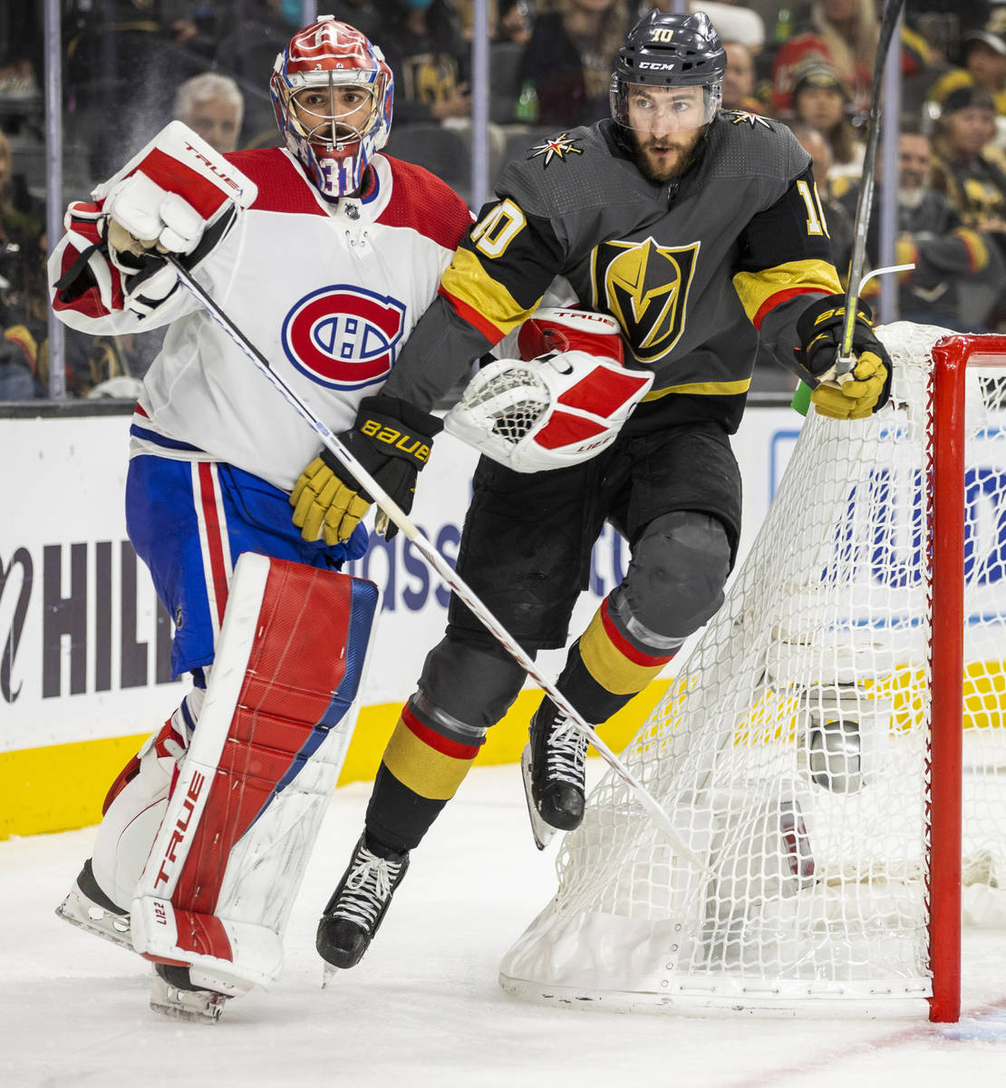 Golden Knights center Nicolas Roy (10) fights for position with Montreal Canadiens goaltender C ...