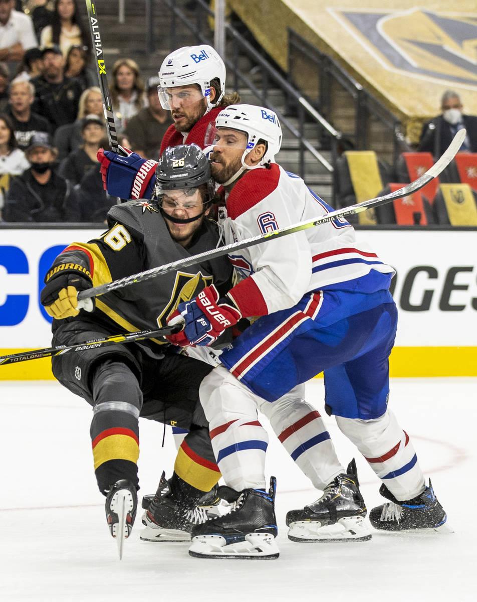 Golden Knights center Mattias Janmark (26) collides with Montreal Canadiens defenseman Shea Web ...