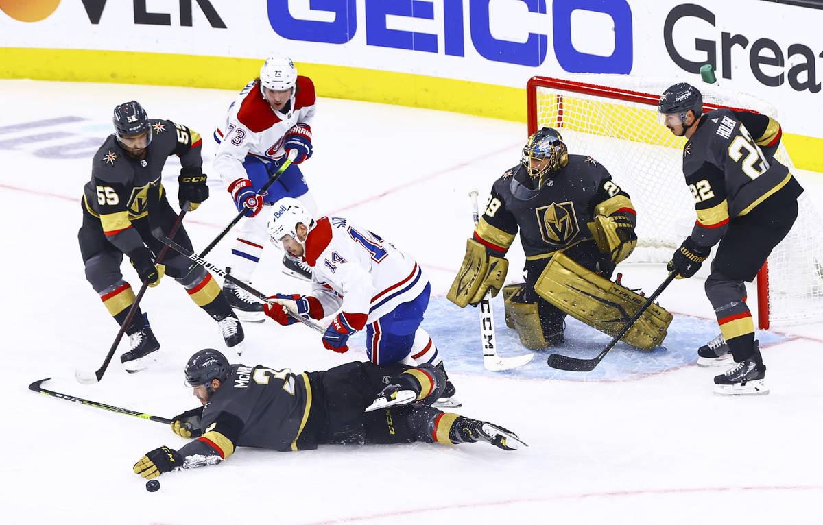 Golden Knights' Brayden McNabb (3) looks to block the puck in front of Montreal Canadiens' Nick ...