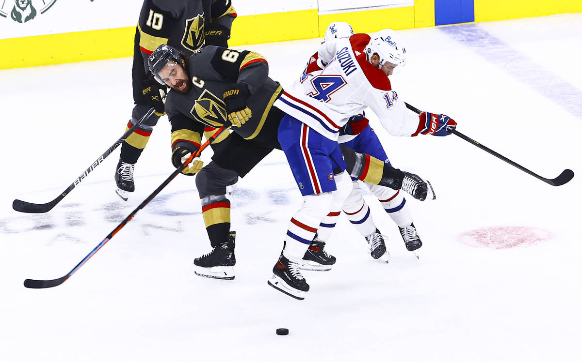 Golden Knights' Mark Stone (61) and Montreal Canadiens' Nick Suzuki (14) get tripped up during ...