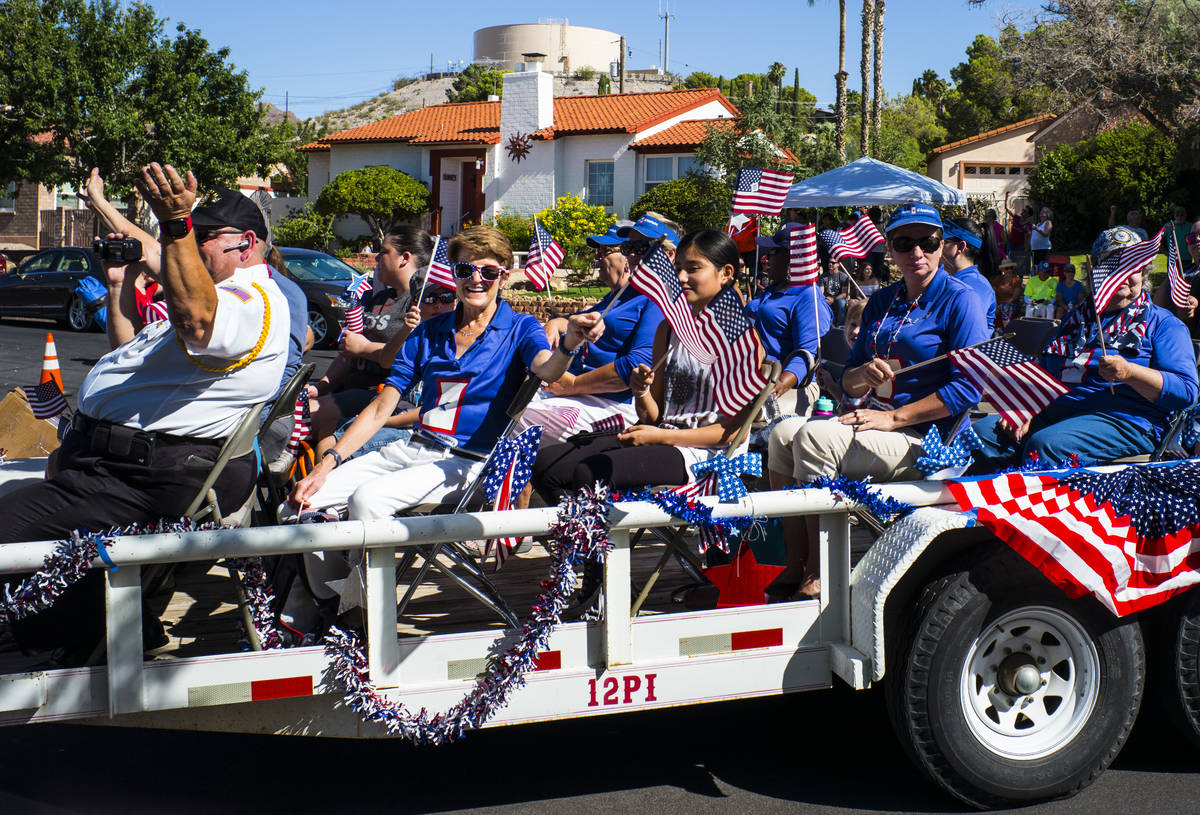 Blue Star Mothers of Nevada wave flags while participating in the parade at the annual Damboree ...