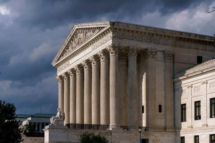 In this June 8, 2021 photo, the Supreme Court is seen in Washington. (AP Photo/J. Scott Applewhite)