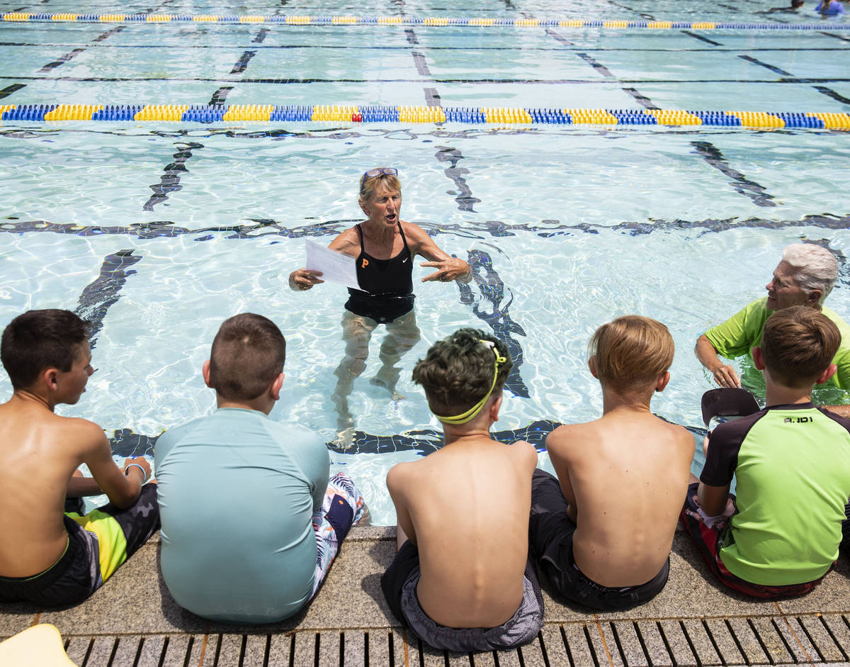 Children listen instructions from Sara Carroll, a volunteer instructor, prior to the start of t ...
