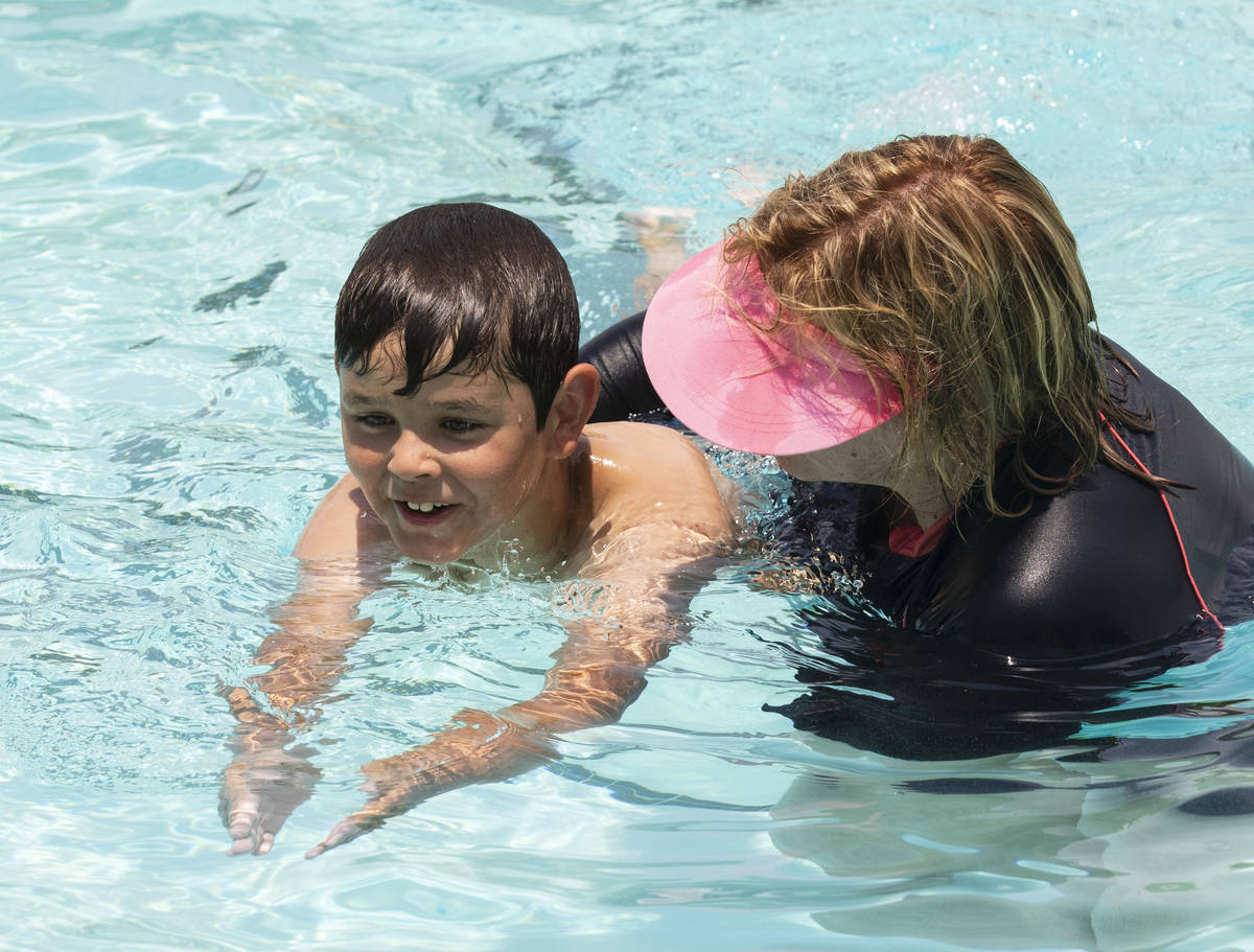 Kim Tyler, a volunteer instructor, helps Landyn Rowe, 10, during the 12th annual World's Larges ...