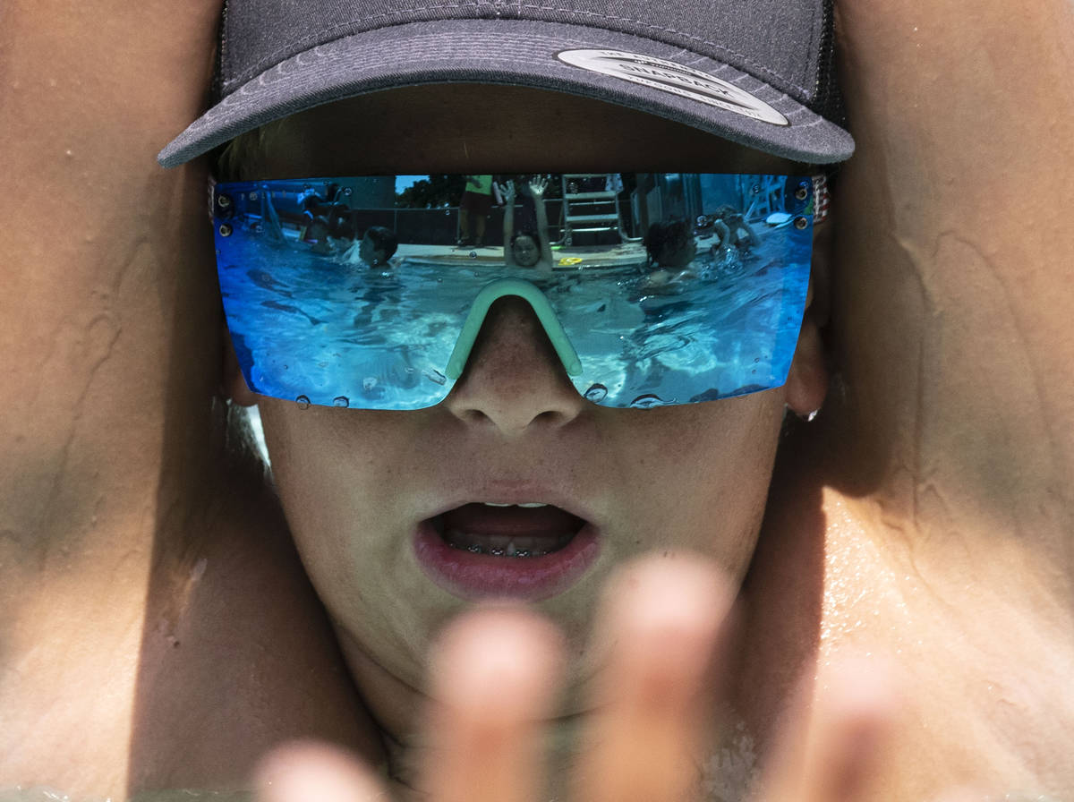 Cruz Stevens, 12, stretches during the 12th annual World's Largest Swimming Lesson at Bo ...