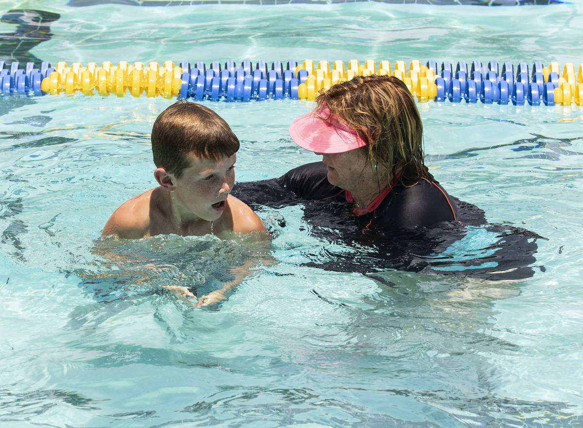 Kim Tyler, a volunteer instructor, helps Colbe Boyle, 10, during the 12th annual World's Larges ...
