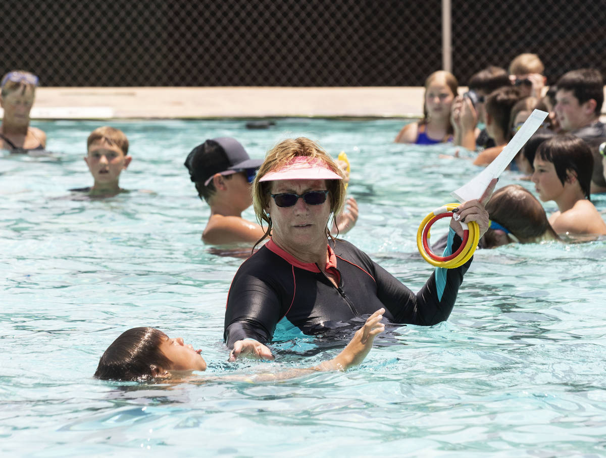 Kim Tyler, a volunteer instructor, watches as children swim during the 12th annual World's Larg ...