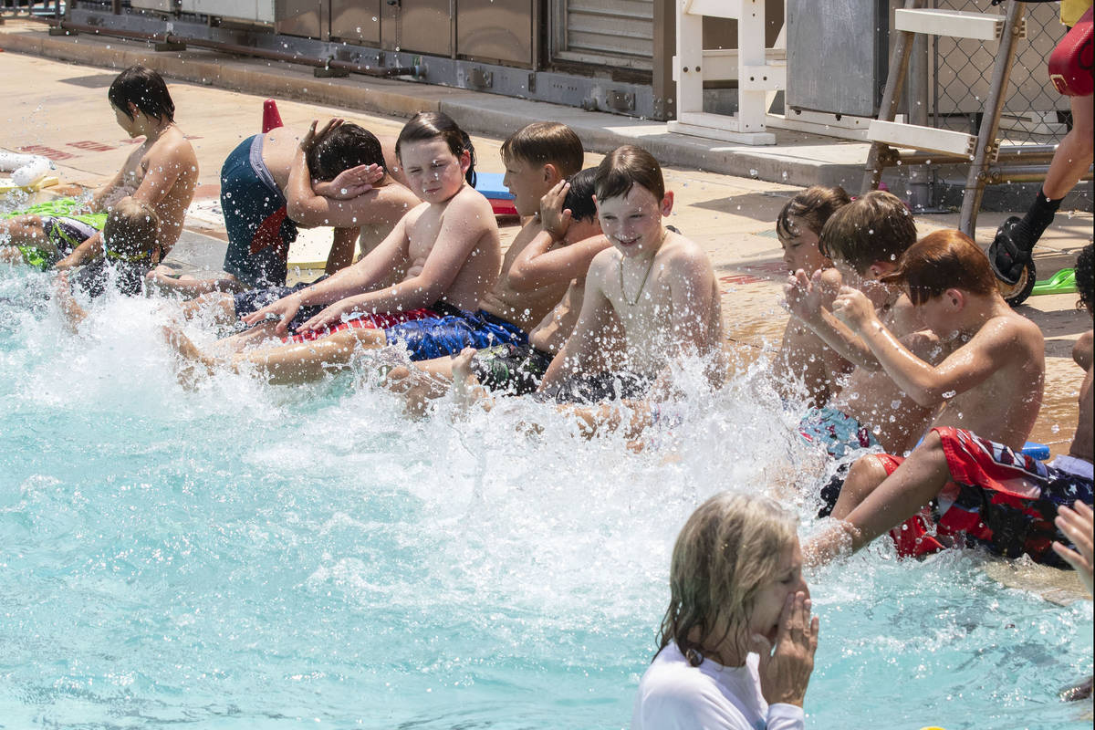 Children splashes water during the 12th annual World's Largest Swimming Lesson at Bould ...