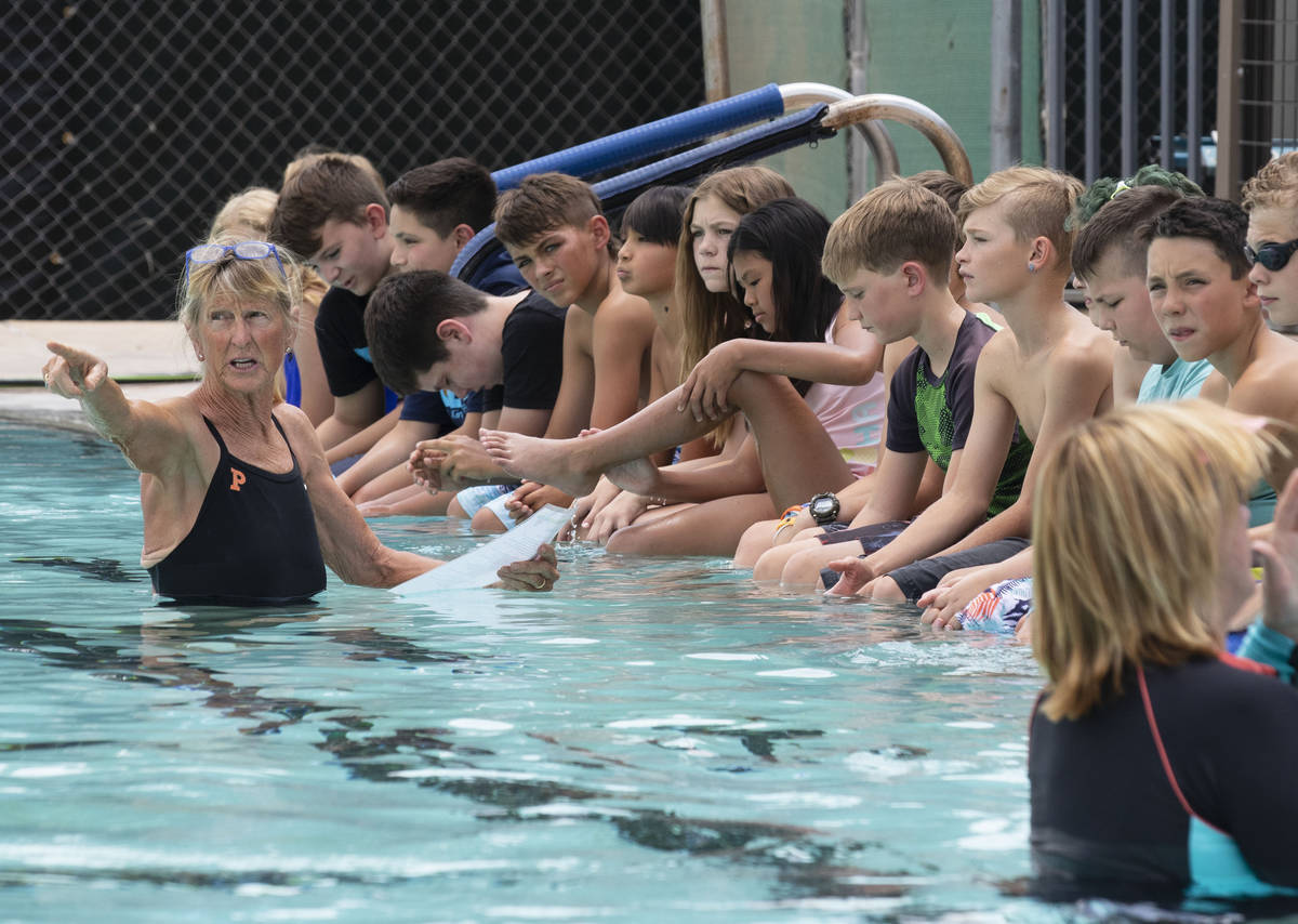 Sara Carroll, a volunteer instructor, instructs children during the 12th annual World's Largest ...