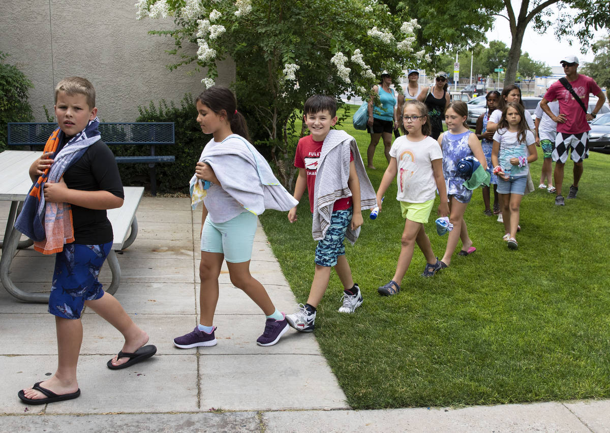 Children arrive to participate in the 12th annual World's Largest Swimming Lesson at Boulder Ci ...
