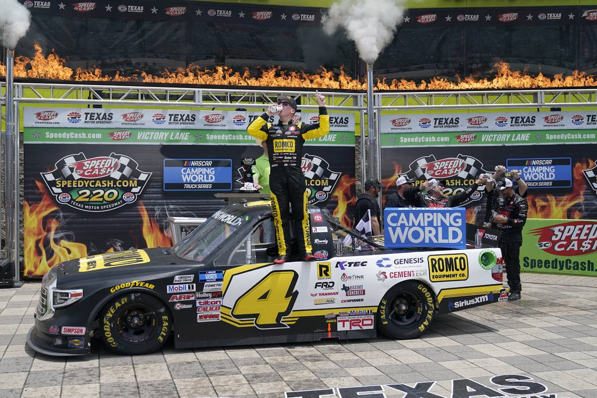 John Hunter Nemechek celebrates in Victory Lane after winning a NASCAR Truck Series auto race a ...