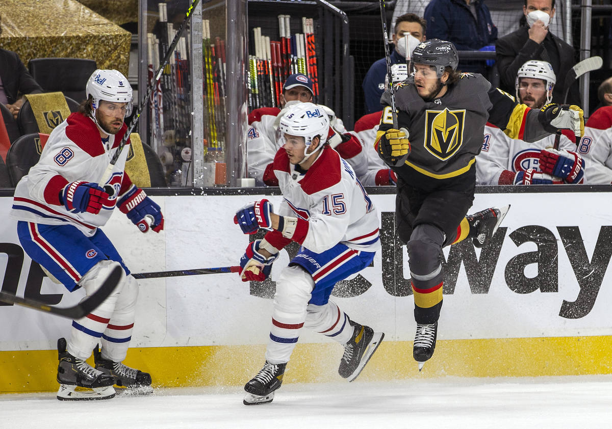 Golden Knights center Mattias Janmark (26) catches some air while avoiding Montreal Canadiens c ...