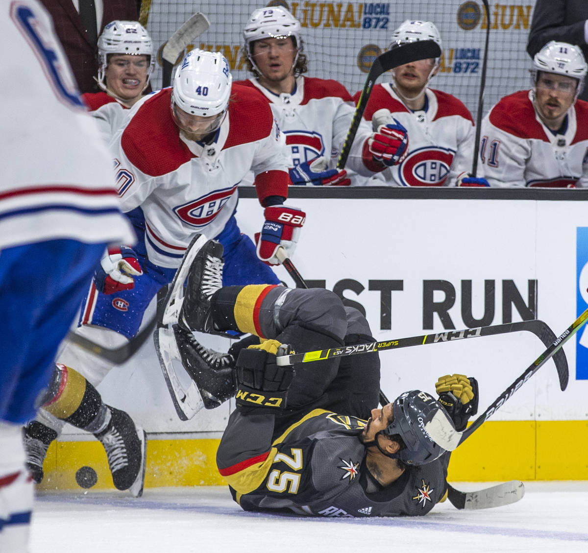 Golden Knights right wing Ryan Reaves (75) is taken to the ice while fighting for the puck with ...