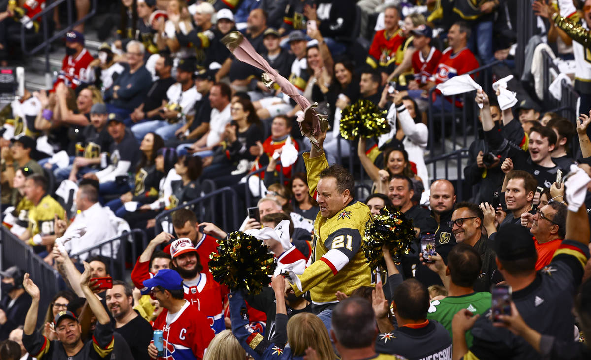 Cameron Hughes performs to hype up the crowd during the first period of Game 2 in an NHL hockey ...