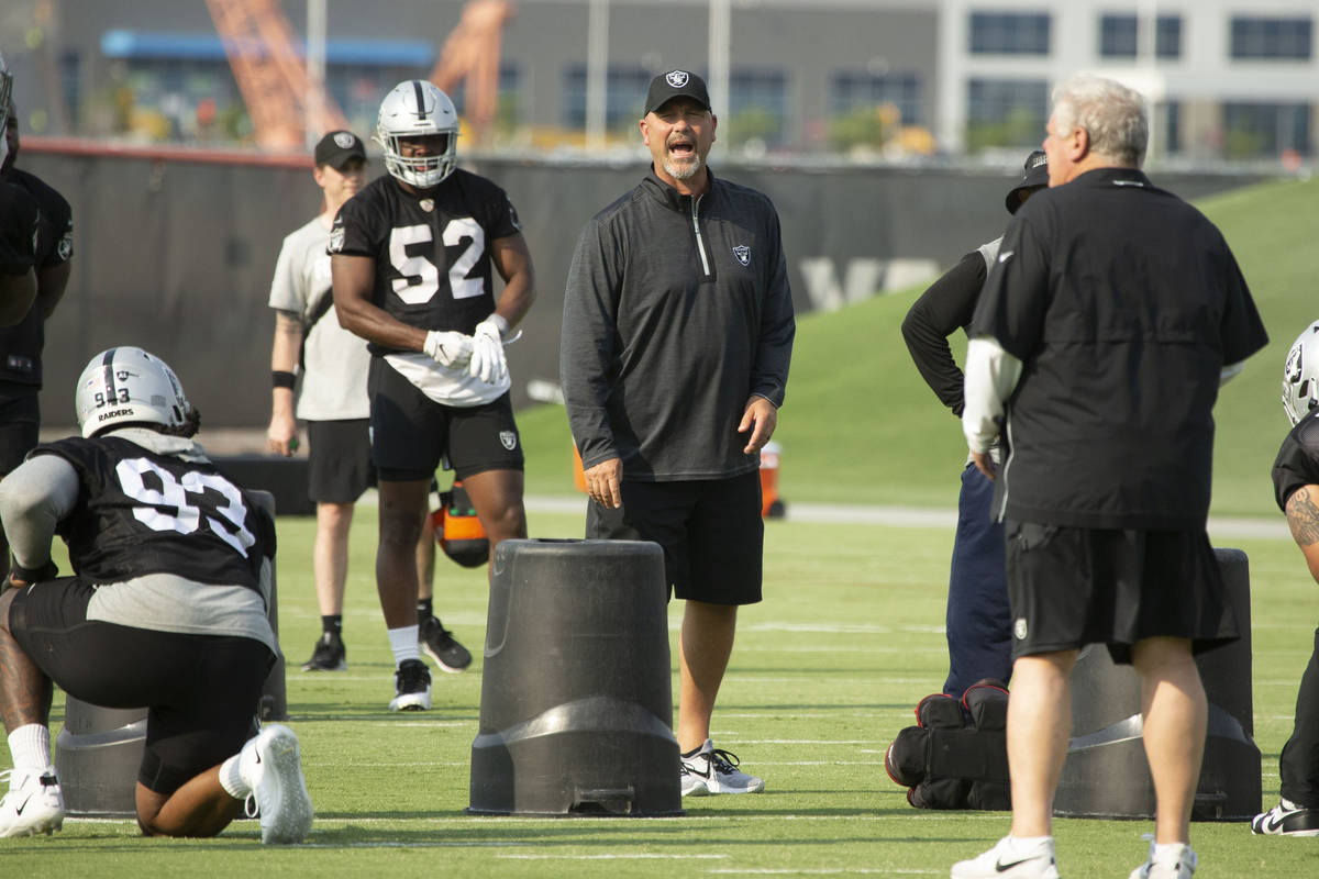 Raiders defensive coordinator Gus Bradley shouts instructions during an NFL football practice o ...