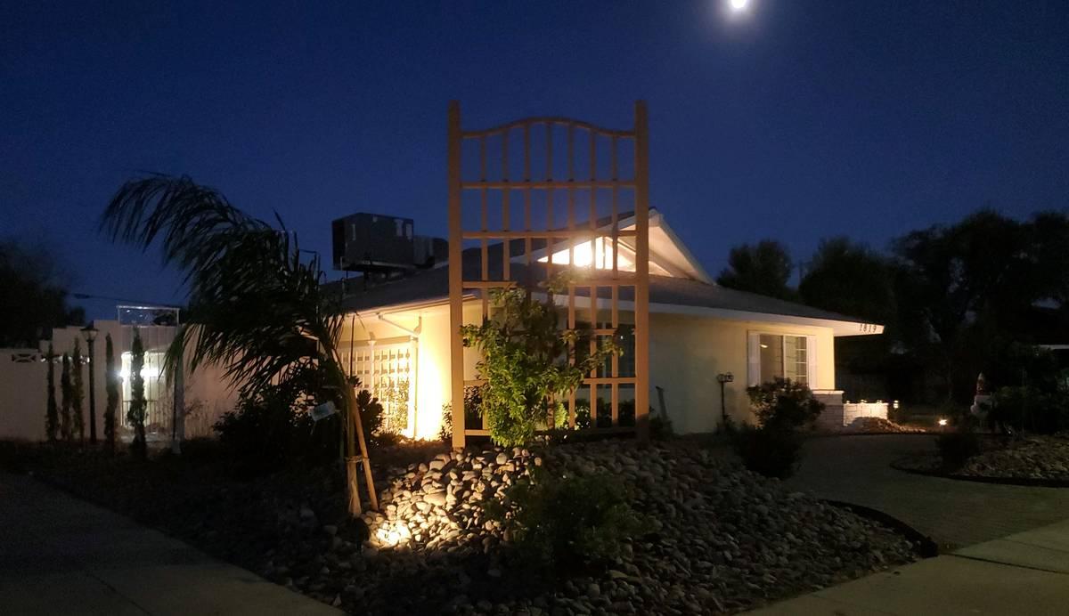 A nighttime exterior view of 1819 Beverly Way. (Kiya Krivickas)