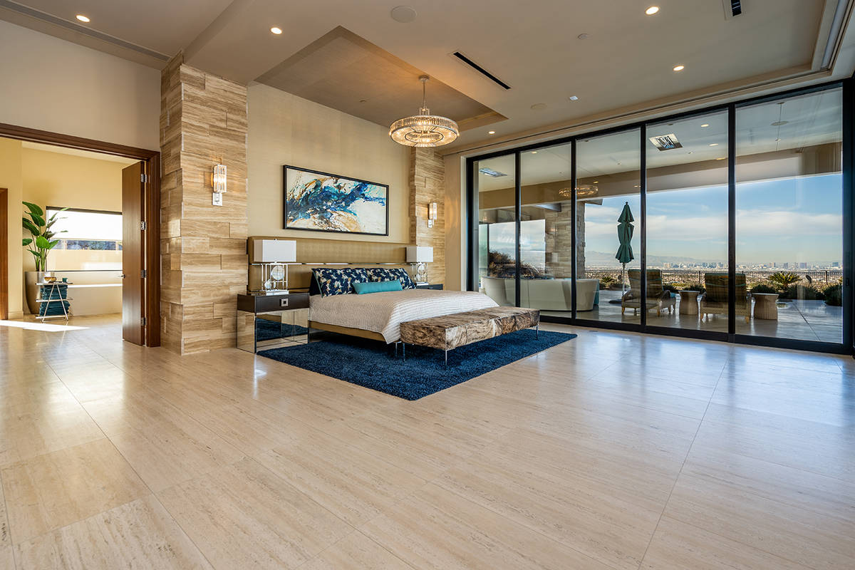 The master suite has access to the oversized pool and cold plunge. (Sun West Luxury Realty)