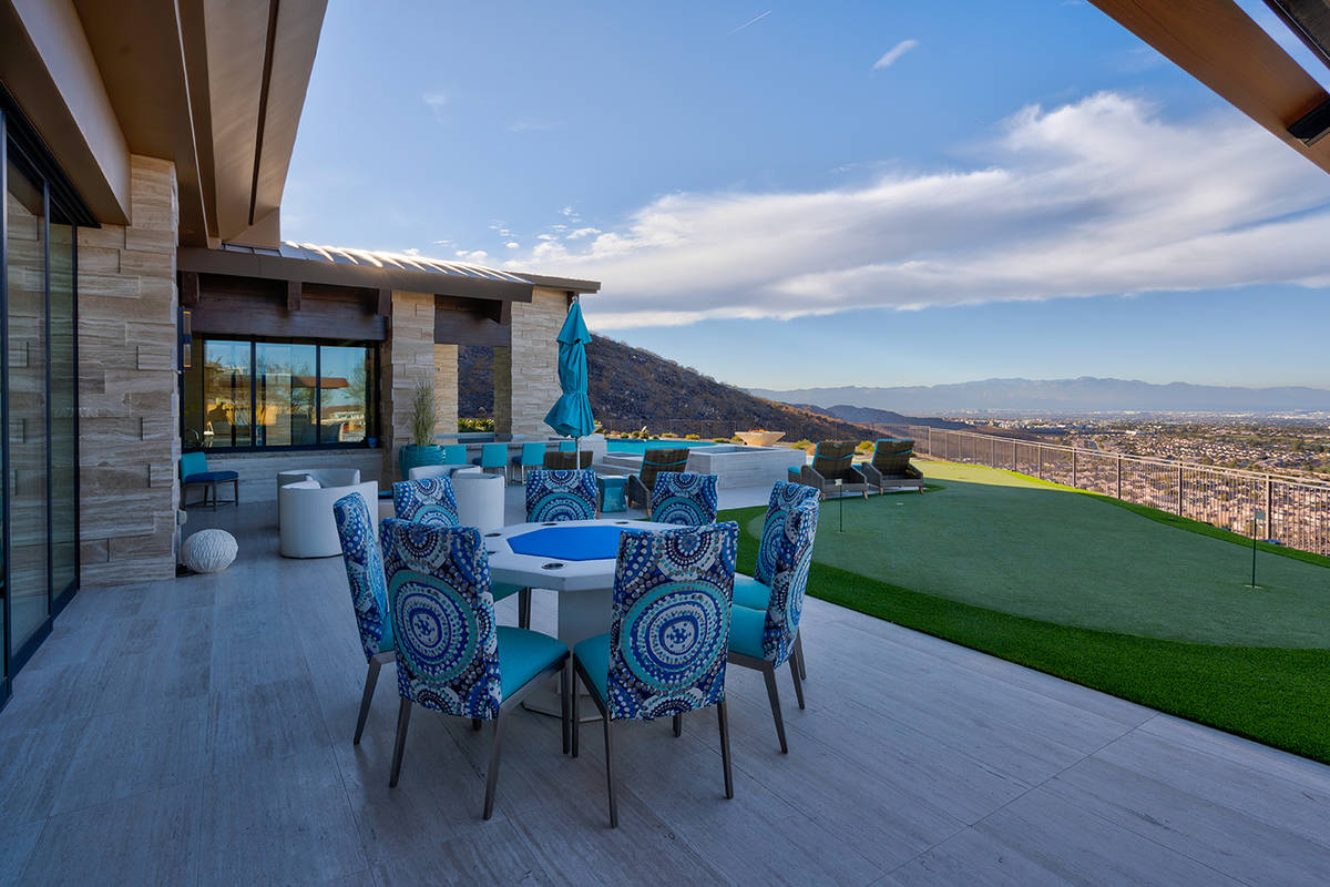 The home has a putting green. (Sun West Luxury Realty)