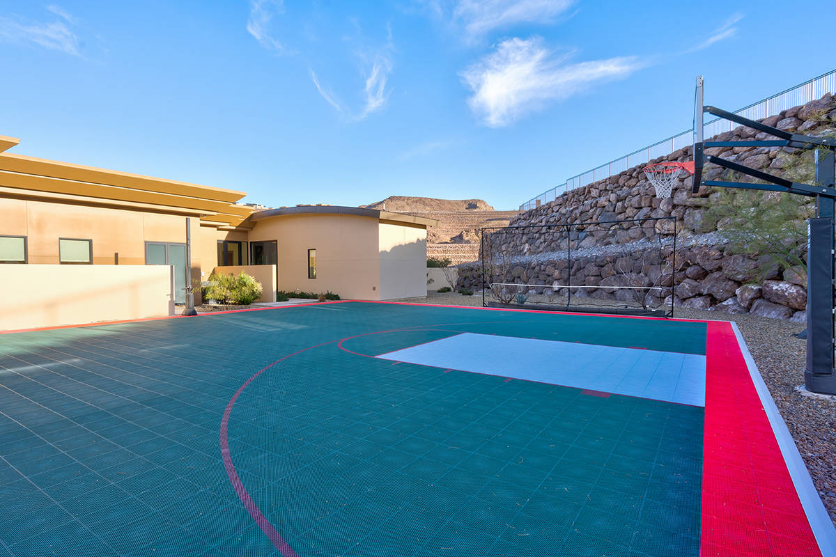 The Ascaya home that belonged to 80-year-plus bachelor Stan Gribble features a sports court. (S ...