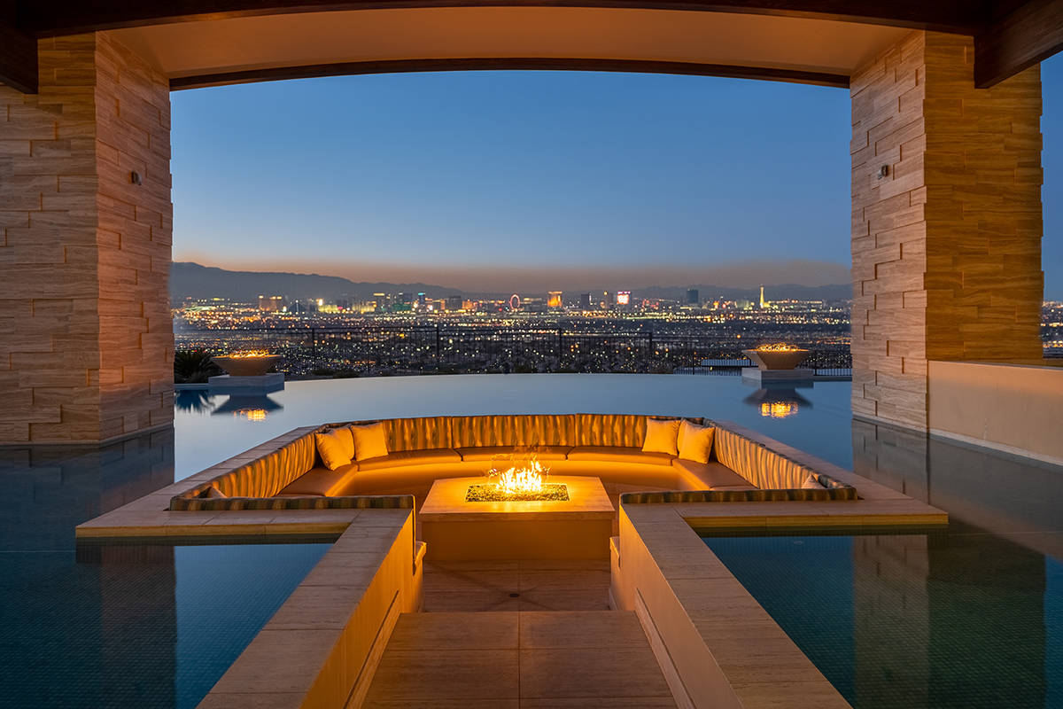 This seating area and fire pit are in the pool and offer sweeping views of the Strip. (Sun West ...