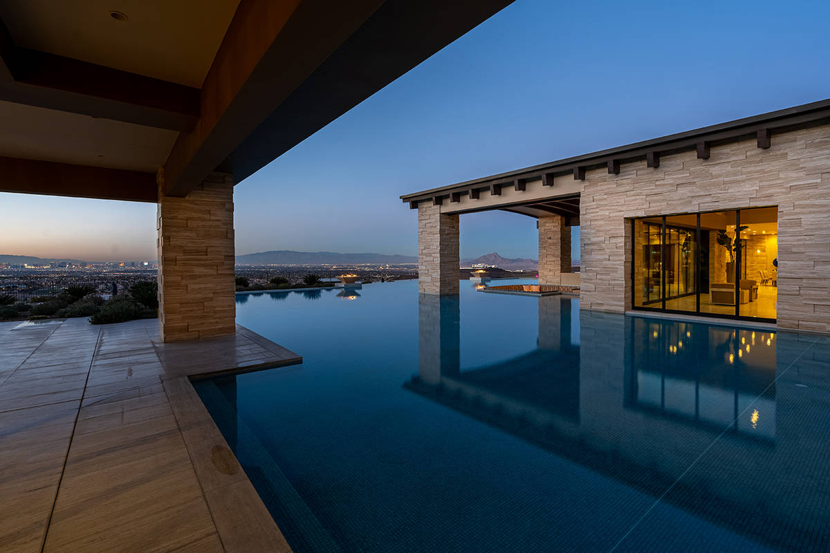 The pool surrounds the home. (Sun West Luxury Realty)