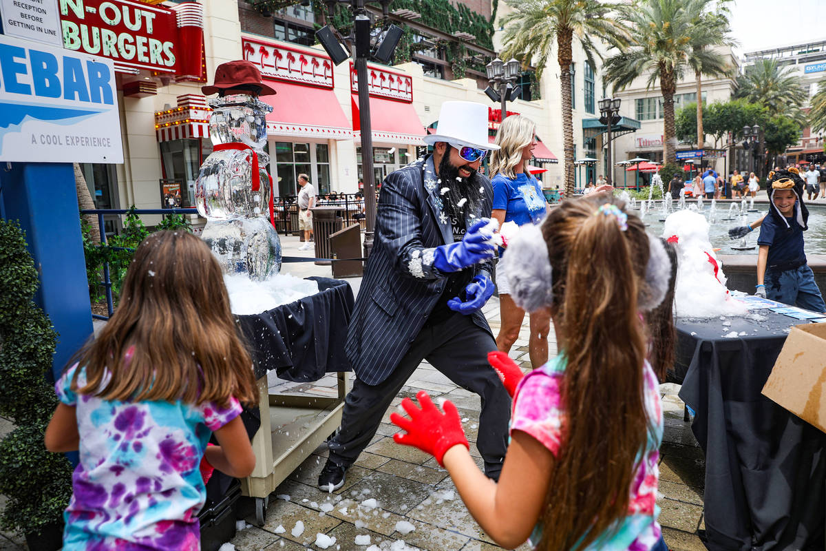 Marco Villarreal, known as ÒVegas Ice Man,Ó has a snowball fight with his daughters a ...