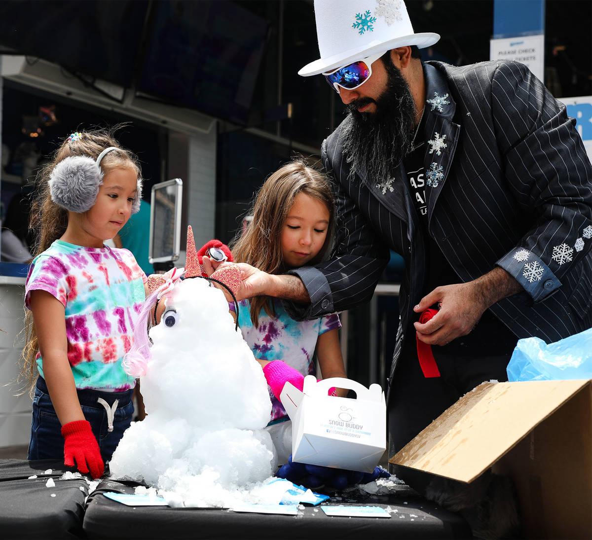 Marco Villarreal, known as ÒVegas Ice Man,Ó helps his daughters Millie Villarreal, 5, ...