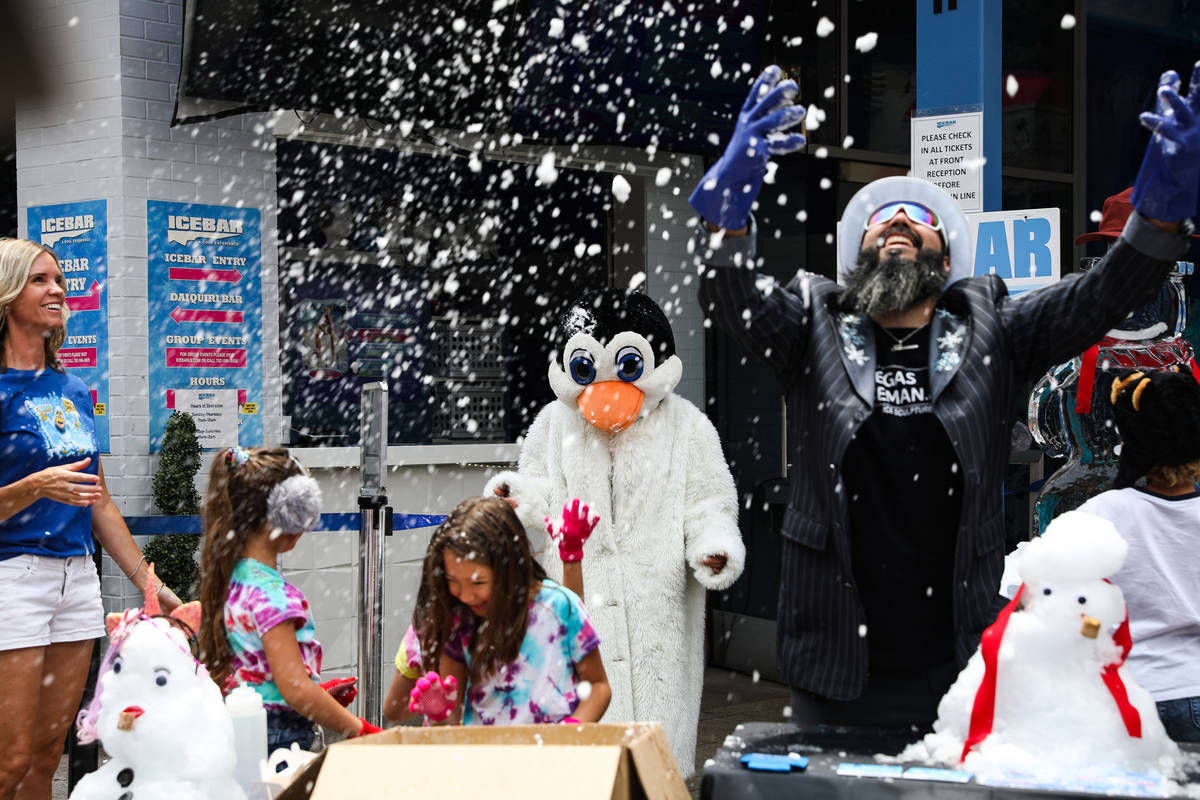 Marco Villarreal, known as ÒVegas Ice Man,Ó throws snow in the air at an event to pro ...